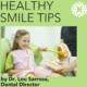 little girl receiving dental education by dentist