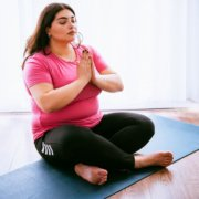 Plus size girl doing yoga