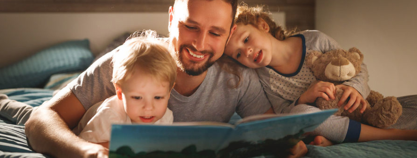 Father reading to kids before bed