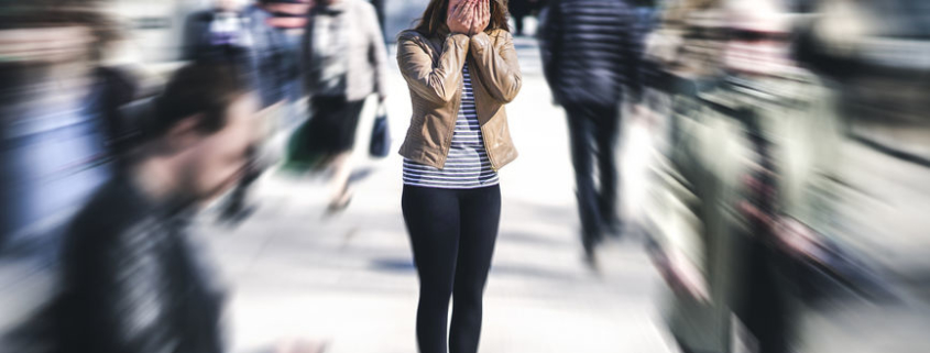 woman with anxiety in public place