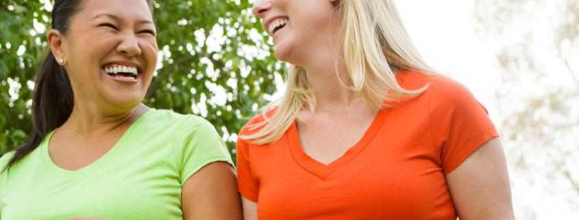Women walking and laughing