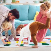 Family playing twister together