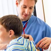Doctor examining boy