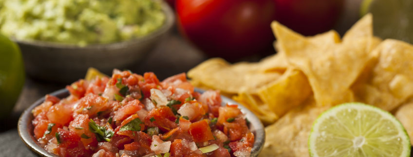 fresh salsa with lentils and chips on the side