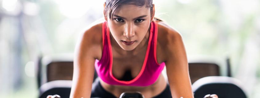 girl exercising on bike